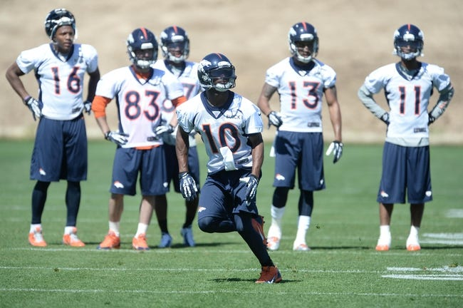 May 28, 2013; Englewood, CO, USA; Denver Broncos wide receiver Emmanuel Sanders (10) runs a drill during organized team activities at the Broncos training facility. Mandatory Credit: Ron Chenoy-USA TODAY Sports