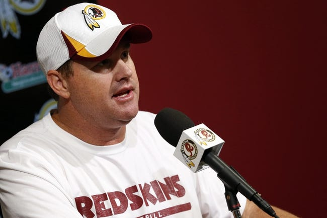 May 29, 2014; Ashburn, VA, USA; Washington Redskins head coach Jay Gruden speaks with the media after organized team activities at Redskins Park. Mandatory Credit: Geoff Burke-USA TODAY Sports