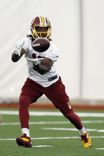 May 29, 2014; Ashburn, VA, USA; Washington Redskins wide receiver Andre Roberts (12) catches the ball during organized team activities at Redskins Park. Mandatory Credit: Geoff Burke-USA TODAY Sports