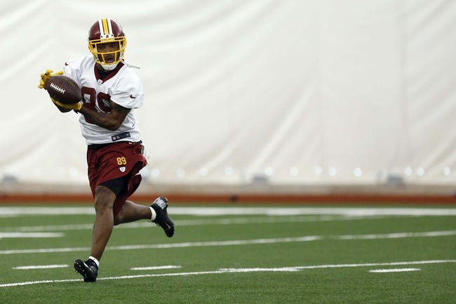 May 29, 2014; Ashburn, VA, USA; Washington Redskins wide receiver Santana Moss (89) catches the ball during organized team activities at Redskins Park. Mandatory Credit: Geoff Burke-USA TODAY Sports