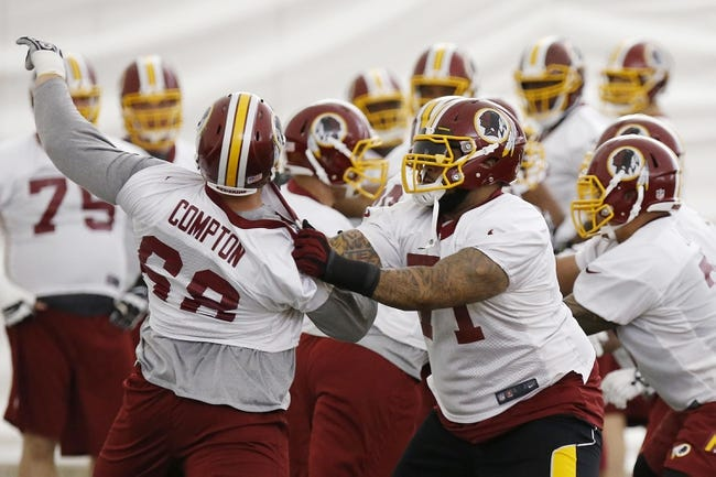 May 29, 2014; Ashburn, VA, USA; Washington Redskins offensive tackle Trent Williams (71) blocks Redskins offensive tackle Tom Compton (68) during organized team activities at Redskins Park. Mandatory Credit: Geoff Burke-USA TODAY Sports