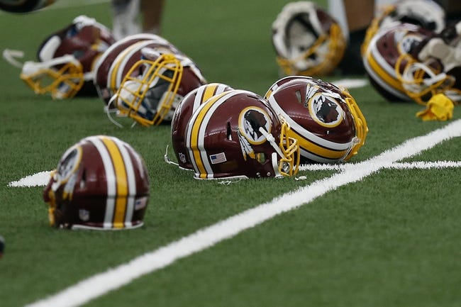 May 29, 2014; Ashburn, VA, USA; Washington Redskins players helmets rest on the field during organized team activities at Redskins Park. Mandatory Credit: Geoff Burke-USA TODAY Sports