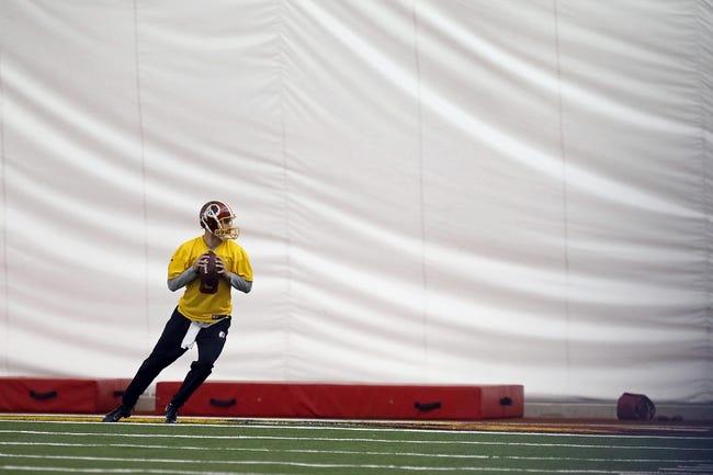 May 29, 2014; Ashburn, VA, USA; Washington Redskins quarterback Kirk Cousins (8) participates in drills during organized team activities at Redskins Park. Mandatory Credit: Geoff Burke-USA TODAY Sports