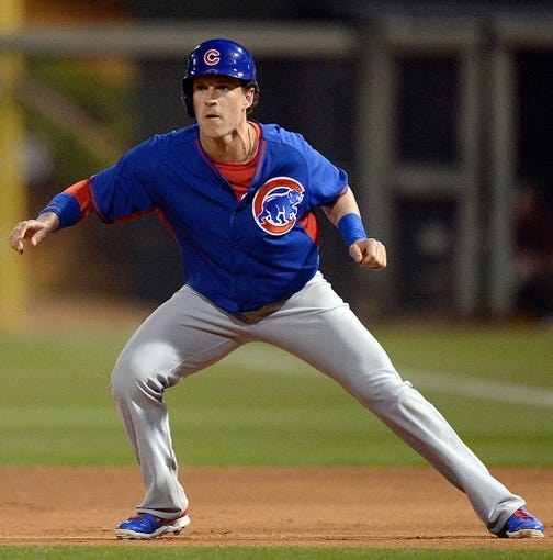 Mar 18, 2014; Surprise, AZ, USA; Chicago Cubs left fielder Chris Coghlan (28) leads off of first base in the first inning against the Texas Rangers at Surprise Stadium. Mandatory Credit: Joe Camporeale-USA TODAY Sports