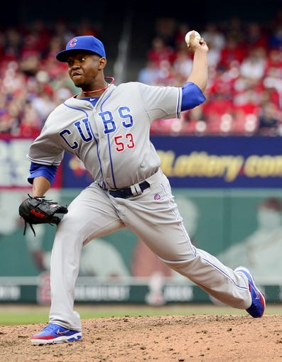 Apr 13, 2014; St. Louis, MO, USA; Chicago Cubs relief pitcher Wesley Wright (53) delivers a pitch against the St. Louis Cardinals at Busch Stadium. The Cardinals defeated the Cubs 6-4. Mandatory Credit: Scott Rovak-USA TODAY Sports