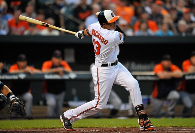 May 12, 2014; Baltimore, MD, USA; Baltimore Orioles third baseman Manny Machado (13) bats in the first inning against the Detroit Tigers at Oriole Park at Camden Yards. The Tigers defeated the Orioles 4-1. Mandatory Credit: Joy R. Absalon-USA TODAY Sports