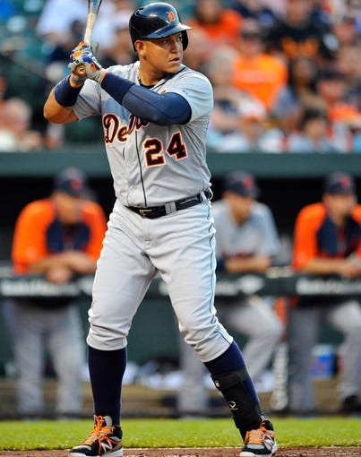 May 12, 2014; Baltimore, MD, USA; Detroit Tigers first baseman Miguel Cabrera (24) bats in the first inning against the Baltimore Orioles at Oriole Park at Camden Yards. The Tigers defeated the Orioles 4-1. Mandatory Credit: Joy R. Absalon-USA TODAY Sports