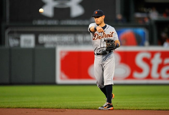 May 12, 2014; Baltimore, MD, USA; Detroit Tigers second baseman Ian Kinsler (3) throws over to first base in the first inning against the Baltimore Orioles at Oriole Park at Camden Yards. The Tigers defeated the Orioles 4-1. Mandatory Credit: Joy R. Absalon-USA TODAY Sports