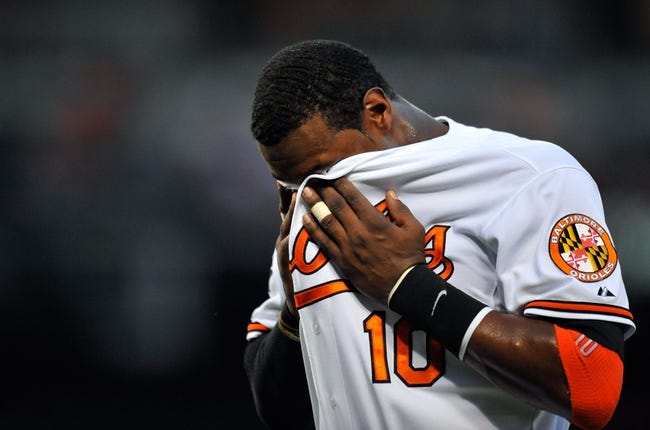 May 12, 2014; Baltimore, MD, USA; Baltimore Orioles center fielder Adam Jones (10) after striking out in the first inning against the Detroit Tigers at Oriole Park at Camden Yards. The Tigers defeated the Orioles 4-1. Mandatory Credit: Joy R. Absalon-USA TODAY Sports