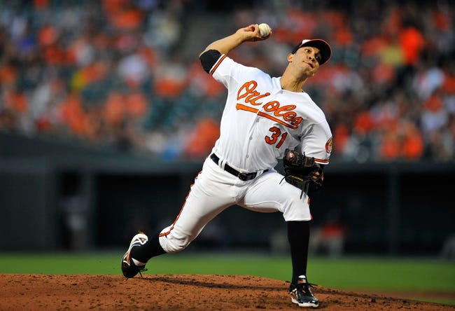 May 13, 2014; Baltimore, MD, USA; Baltimore Orioles starting pitcher Ubaldo Jimenez (31) throws in the third inning against the Detroit Tigers at Oriole Park at Camden Yards. The Tigers defeated the Orioles 4-1. Mandatory Credit: Joy R. Absalon-USA TODAY Sports