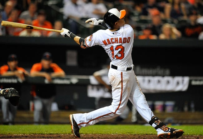 May 12, 2014; Baltimore, MD, USA; Baltimore Orioles third baseman Manny Machado (13) bats in the eighth inning against the Detroit Tigers at Oriole Park at Camden Yards. The Tigers defeated the Orioles 4-1. Mandatory Credit: Joy R. Absalon-USA TODAY Sports