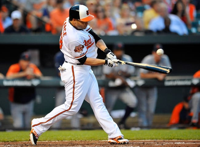 May 13, 2014; Baltimore, MD, USA; Baltimore Orioles designated hitter Steve Pearce (28) bats in the second inning against the Detroit Tigers at Oriole Park at Camden Yards. The Tigers defeated the Orioles 4-1. Mandatory Credit: Joy R. Absalon-USA TODAY Sports