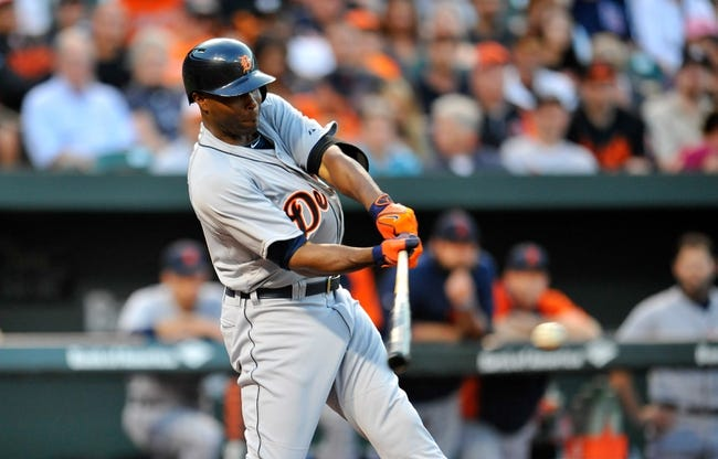 May 12, 2014; Baltimore, MD, USA; Detroit Tigers right fielder Torii Hunter (48) bats in the first inning against the Baltimore Orioles at Oriole Park at Camden Yards. The Tigers defeated the Orioles 4-1. Mandatory Credit: Joy R. Absalon-USA TODAY Sports