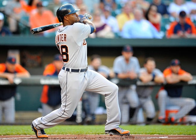 May 13, 2014; Baltimore, MD, USA; Detroit Tigers right fielder Torii Hunter (48) bats in the first inning against the Baltimore Orioles at Oriole Park at Camden Yards. The Tigers defeated the Orioles 4-1. Mandatory Credit: Joy R. Absalon-USA TODAY Sports