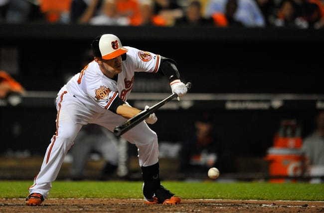 May 13, 2014; Baltimore, MD, USA; Baltimore Orioles catcher Caleb Joseph (36) lays down a sac bunt in the seventh inning against the Detroit Tigers at Oriole Park at Camden Yards. The Tigers defeated the Orioles 4-1. Mandatory Credit: Joy R. Absalon-USA TODAY Sports