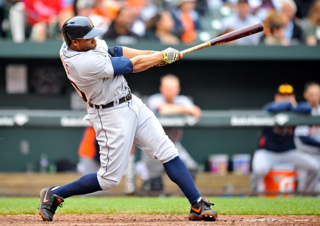 May 14, 2014; Baltimore, MD, USA; Detroit Tigers left fielder Rajai Davis (20) bats in the sixth inning against the Baltimore Orioles at Oriole Park at Camden Yards. The Tigers defeated the Orioles 7-5. Mandatory Credit: Joy R. Absalon-USA TODAY Sports