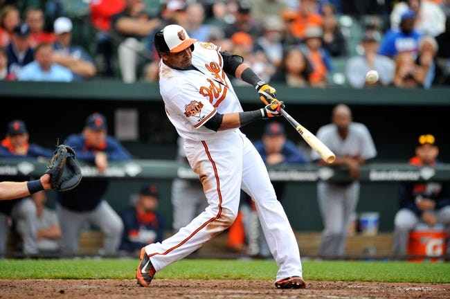 May 14, 2014; Baltimore, MD, USA; Baltimore Orioles designated hitter Nelson Cruz (23) bats in the eighth inning against the Detroit Tigers at Oriole Park at Camden Yards. The Tigers defeated the Orioles 7-5. Mandatory Credit: Joy R. Absalon-USA TODAY Sports