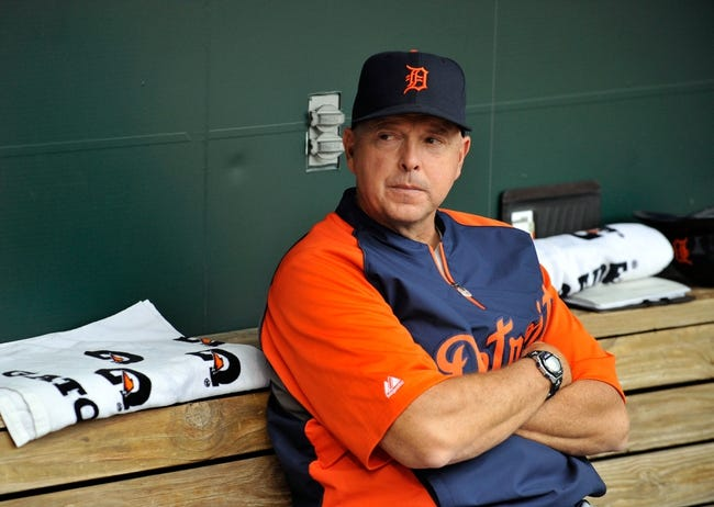 May 14, 2014; Baltimore, MD, USA; Detroit Tigers hitting coach Wally Joyner (8) prior to a game against the Baltimore Orioles at Oriole Park at Camden Yards. The Tigers defeated the Orioles 7-5. Mandatory Credit: Joy R. Absalon-USA TODAY Sports