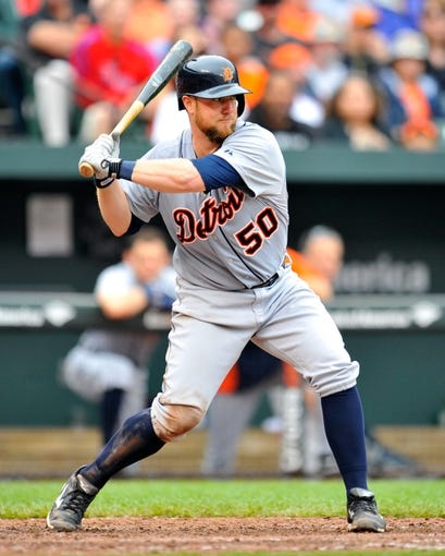 May 14, 2014; Baltimore, MD, USA; Detroit Tigers catcher Bryan Holaday (50) bats in the sixth inning against the Baltimore Orioles at Oriole Park at Camden Yards. The Tigers defeated the Orioles 7-5. Mandatory Credit: Joy R. Absalon-USA TODAY Sports