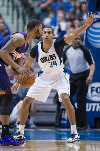 Apr 12, 2014; Dallas, TX, USA; Dallas Mavericks forward Brandan Wright (34) during the game against the Phoenix Suns at the American Airlines Center. The Mavericks defeated the Suns 101-98. Mandatory Credit: Jerome Miron-USA TODAY Sports