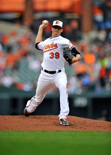May 14, 2014; Baltimore, MD, USA; Baltimore Orioles starting pitcher Kevin Gausman (39) pitches in the second inning against the Detroit Tigers at Oriole Park at Camden Yards. The Tigers defeated the Orioles 7-5. Mandatory Credit: Joy R. Absalon-USA TODAY Sports