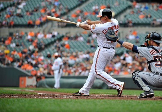 May 14, 2014; Baltimore, MD, USA; Baltimore Orioles catcher Steve Clevenger (45) bats in the second inning against the Detroit Tigers at Oriole Park at Camden Yards. The Tigers defeated the Orioles 7-5. Mandatory Credit: Joy R. Absalon-USA TODAY Sports