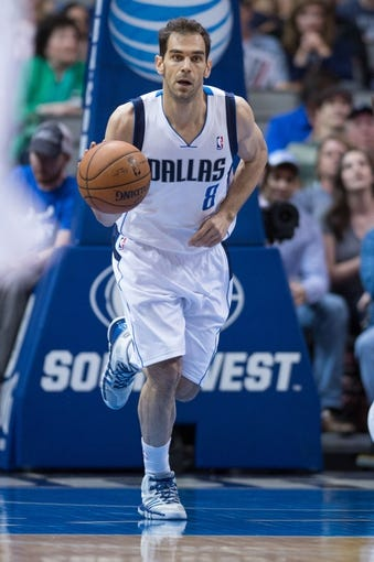 Apr 12, 2014; Dallas, TX, USA; Dallas Mavericks guard Jose Calderon (8) during the game against the Phoenix Suns at the American Airlines Center. The Mavericks defeated the Suns 101-98. Mandatory Credit: Jerome Miron-USA TODAY Sports