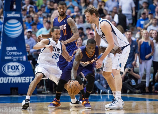 Apr 12, 2014; Dallas, TX, USA; Phoenix Suns guard Eric Bledsoe (2) and Dallas Mavericks guard Devin Harris (20) and forward Dirk Nowitzki (41) during the game at the American Airlines Center. The Mavericks defeated the Suns 101-98. Mandatory Credit: Jerome Miron-USA TODAY Sports
