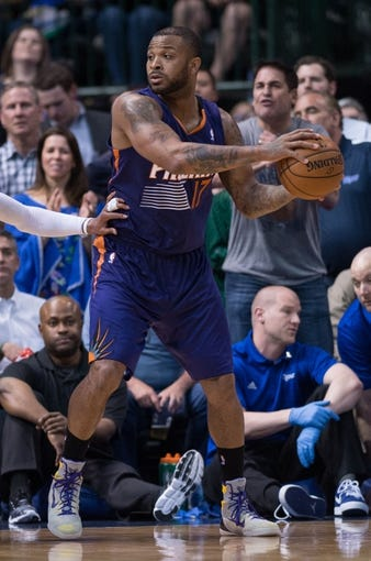 Apr 12, 2014; Dallas, TX, USA; Phoenix Suns forward P.J. Tucker (17) during the game against the Dallas Mavericks at the American Airlines Center. The Mavericks defeated the Suns 101-98. Mandatory Credit: Jerome Miron-USA TODAY Sports