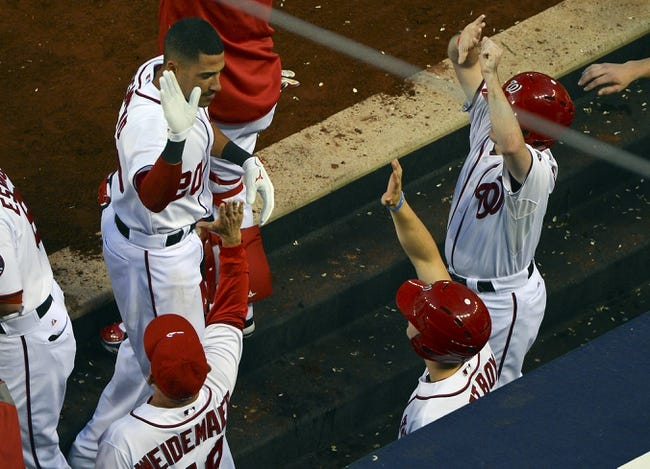 May 30, 2014; Washington, DC, USA; Washington Nationals shortstop Ian Desmond (20) celebrates with  teammates in the dugout  after hitting a three run home run in the fourth inning against the Texas Rangers at Nationals Park. Mandatory Credit: Tommy Gilligan-USA TODAY Sports