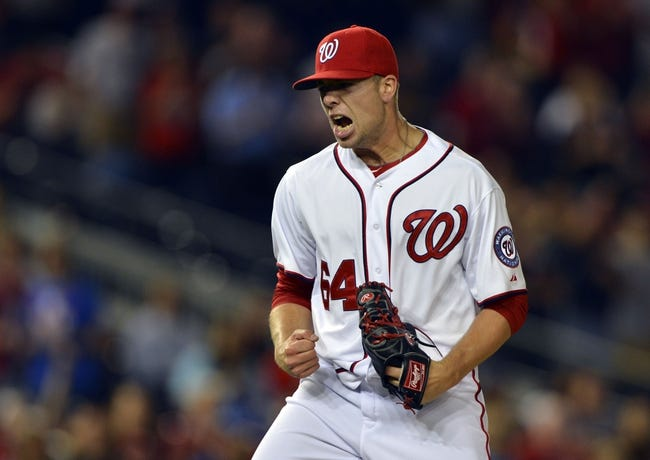 May 30, 2014; Washington, DC, USA; Washington Nationals relief pitcher Blake Treinen (64) celebrates after striking out Texas Rangers second baseman Luis Sardinas (not pictured) for the final out in the ninth inning at Nationals Park. Washington Nationals defeated the Texas Rangers 9-2. Mandatory Credit: Tommy Gilligan-USA TODAY Sports