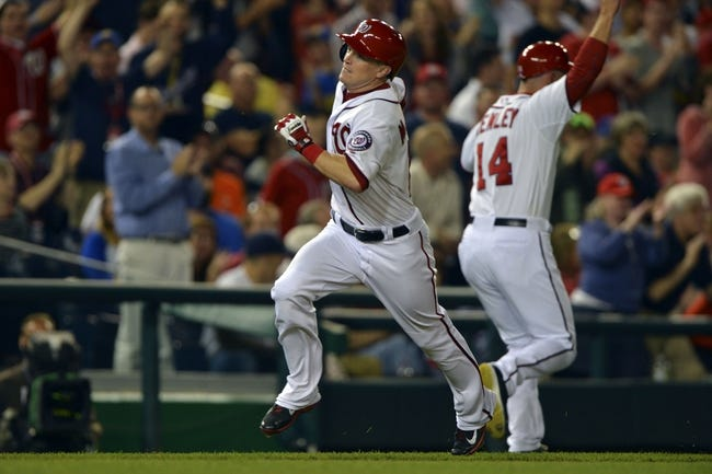 May 30, 2014; Washington, DC, USA; Washington Nationals left fielder Nate McLouth (15) runs and scores during the sixth inning against the Texas Rangers at Nationals Park. Washington Nationals defeated the Texas Rangers 9-2. Mandatory Credit: Tommy Gilligan-USA TODAY Sports