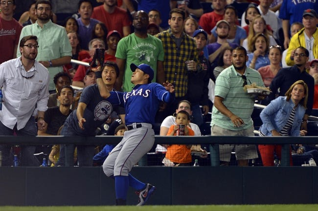 May 30, 2014; Washington, DC, USA; Texas Rangers left fielder Shin-Soo Choo (17) catches Washington Nationals center fielder Denard Span (not pictured) pop-fly in the sixth inning at Nationals Park. Washington Nationals defeated the Texas Rangers 9-2. Mandatory Credit: Tommy Gilligan-USA TODAY Sports