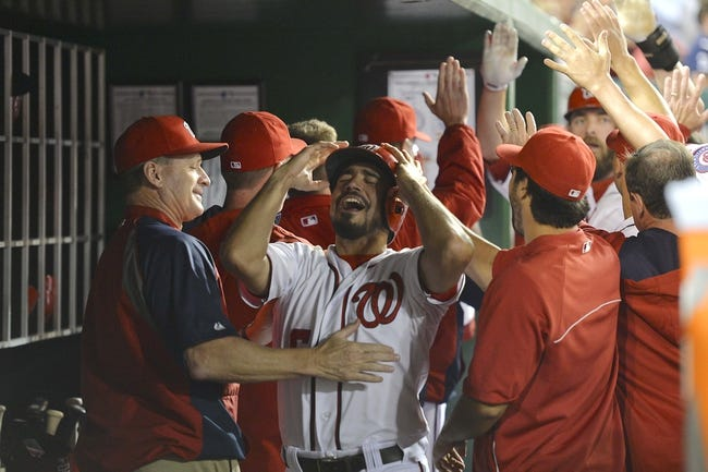 May 30, 2014; Washington, DC, USA; Washington Nationals third baseman Anthony Rendon (6) celebrates with his teammate in the dugout after scoring in the seventh inning against the Texas Rangers at Nationals Park. Washington Nationals defeated the Texas Rangers 9-2. Mandatory Credit: Tommy Gilligan-USA TODAY Sports