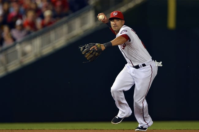 May 30, 2014; Washington, DC, USA; Washington Nationals shortstop Ian Desmond (20) catches a Texas Rangers shortstop Elvis Andrus (not pictured) grounder and throws to first base during the seventh inning at Nationals Park. Washington Nationals defeated the Texas Rangers 9-2. Mandatory Credit: Tommy Gilligan-USA TODAY Sports