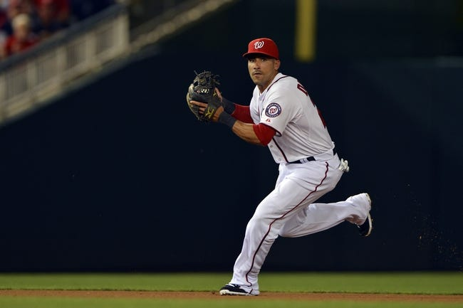 May 30, 2014; Washington, DC, USA; Washington Nationals shortstop Ian Desmond (20) catches a Texas Rangers shortstop Elvis Andrus (not pictured) grounder during the seventh inning at Nationals Park. Washington Nationals defeated the Texas Rangers 9-2. Mandatory Credit: Tommy Gilligan-USA TODAY Sports