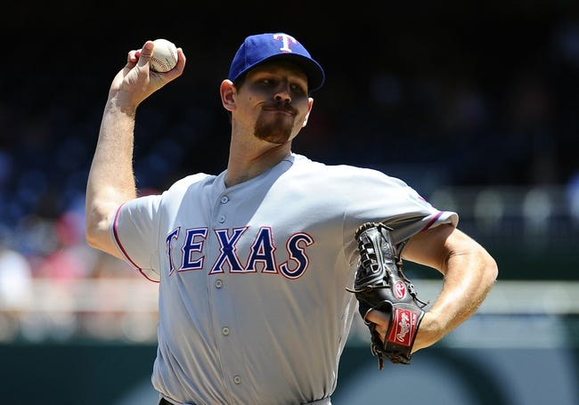 May 31, 2014; Washington, DC, USA; Texas Rangers starting pitcher Nick Tepesch (23) throws during the first inning against the Washington Nationals at Nationals Park. Mandatory Credit: Brad Mills-USA TODAY Sports