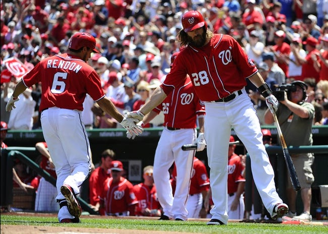 May 31, 2014; Washington, DC, USA; Washington Nationals third baseman Anthony Rendon (6) is congratulated by Washington Nationals right fielder Jayson Werth (28) after hitting a solo home run against the Texas Rangers during the first inning at Nationals Park. Mandatory Credit: Brad Mills-USA TODAY Sports
