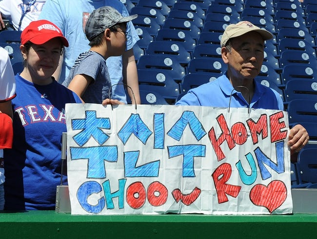 May 31, 2014; Washington, DC, USA; Fans of Texas Rangers left fielder Shin-Soo Choo (not shown) before the game against the Washington Nationals at Nationals Park. Mandatory Credit: Brad Mills-USA TODAY Sports