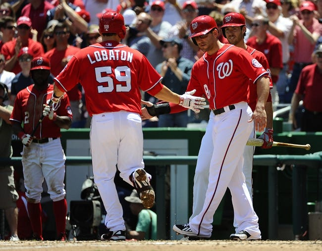 May 31, 2014; Washington, DC, USA; Washington Nationals catcher Jose Lobaton (59) is congratulated by second baseman Danny Espinosa (8) after hitting a two run home run against the Texas Rangers during the second inning at Nationals Park. Mandatory Credit: Brad Mills-USA TODAY Sports