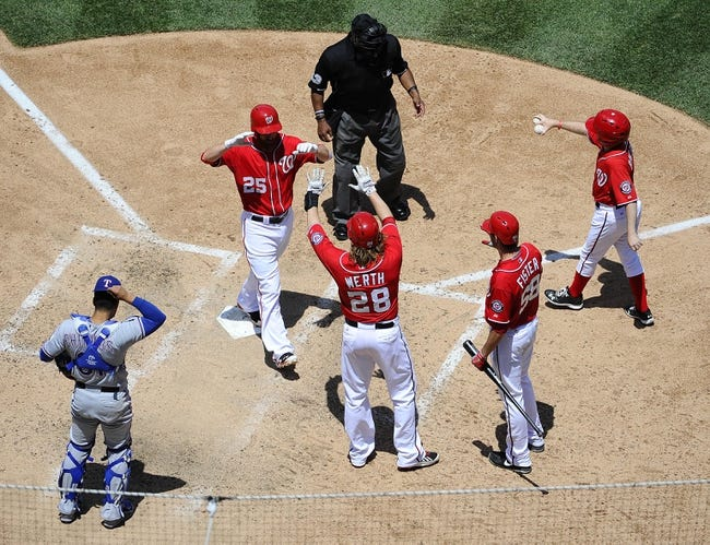 May 31, 2014; Washington, DC, USA; Washington Nationals first baseman Adam LaRoche (25) is greeted at home after hitting a three run home run by Washington Nationals right fielder Jayson Werth (28) and Doug Fister (58) during the fourth inning against the Texas Rangers at Nationals Park. Mandatory Credit: Brad Mills-USA TODAY Sports
