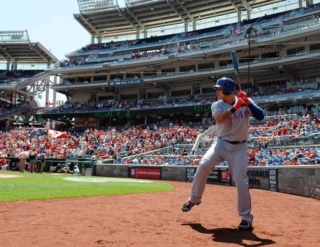 May 31, 2014; Washington, DC, USA; Texas Rangers left fielder Shin-Soo Choo (17) warms up against the Washington Nationals during the first inning at Nationals Park. Mandatory Credit: Brad Mills-USA TODAY Sports