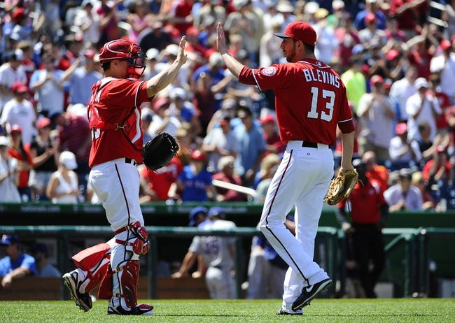 May 31, 2014; Washington, DC, USA; Washington Nationals relief pitcher Jerry Blevins (13) is congratulated by Washington Nationals catcher Jose Lobaton (59) after recording the final out against the Texas Rangers at Nationals Park. Mandatory Credit: Brad Mills-USA TODAY Sports