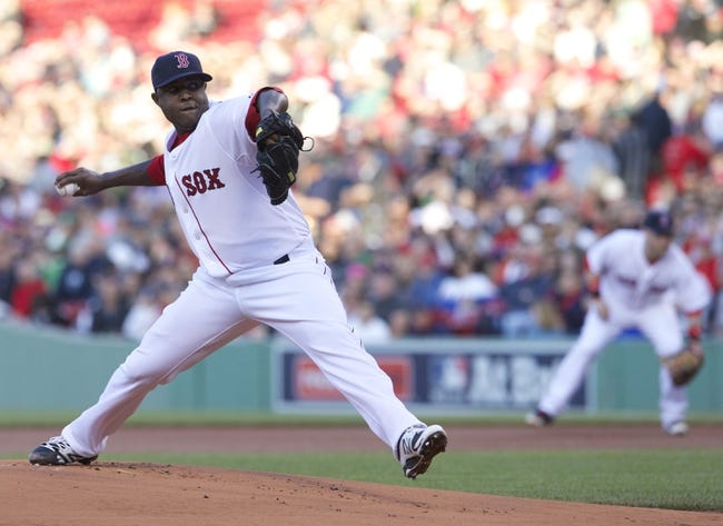May 31, 2014; Boston, MA, USA; Boston Red Sox starting pitcher Rubby De La Rosa (62) throws the ball against the Tampa Bay Rays in the first inning at Fenway Park. Mandatory Credit: David Butler II-USA TODAY Sports
