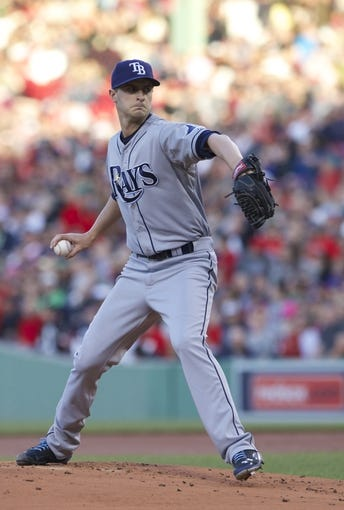 May 31, 2014; Boston, MA, USA; Tampa Bay Rays starting pitcher Jake Odorizzi (23) throws the ball against the Boston Red Sox in the first inning at Fenway Park. Mandatory Credit: David Butler II-USA TODAY Sports