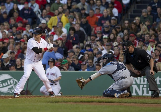 May 31, 2014; Boston, MA, USA; Boston Red Sox left fielder Mike Carp (37) is hit by a pitch by Tampa Bay Rays starting pitcher Jake Odorizzi (not pictured) in the second inning at Fenway Park. Mandatory Credit: David Butler II-USA TODAY Sports