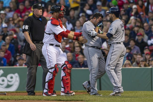 May 31, 2014; Boston, MA, USA; Tampa Bay Rays catcher Jose Molina (28) reacts after being hit by the ball off the glove of Boston Red Sox catcher A.J. Pierzynski (40) in the third inning at Fenway Park. Mandatory Credit: David Butler II-USA TODAY Sports
