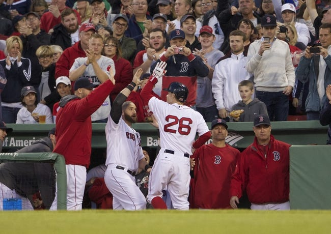 May 31, 2014; Boston, MA, USA; Boston Red Sox third baseman Brock Holt (26) celebrates with teammates after hitting a two run home-run against the Tampa Bay Rays in the third inning at Fenway Park. Mandatory Credit: David Butler II-USA TODAY Sports