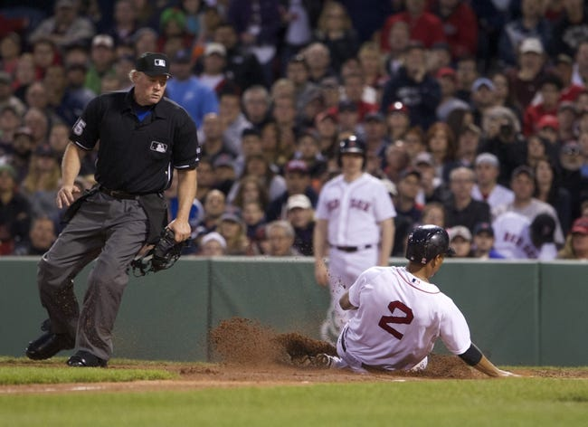 May 31, 2014; Boston, MA, USA; Boston Red Sox shortstop Xander Bogaerts (2) scores on a sacrifice fly ball to center field by left fielder Mike Carp (37) against the Tampa Bay Rays in the third inning at Fenway Park. Mandatory Credit: David Butler II-USA TODAY Sports