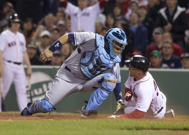 May 31, 2014; Boston, MA, USA; Boston Red Sox left fielder Grady Sizemore (38) scores on a bunt by second baseman Jonathan Herrera (not pictured) against Tampa Bay Rays catcher Jose Molina (28) in the fourth inning at Fenway Park. Mandatory Credit: David Butler II-USA TODAY Sports